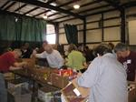 UMass Alumni sorting post office drive food